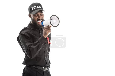 smiling african american police officer with aids awareness red ribbon shouting with megaphone isolated on white