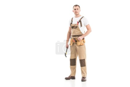 attractive adult builder with aids awareness red ribbon on overall isolated on white