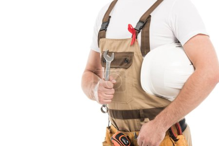 cropped shot of builder with aids awareness red ribbon on overall holding wrench and helmet isolated on white