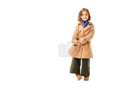 beautiful little child in trench coat looking at camera isolated on white
