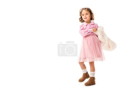 adorable little child in pink clothes and white fur coat isolated on white