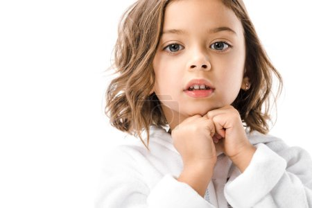 portrait of adorable child in white bathrobe looking at camera isolated on white
