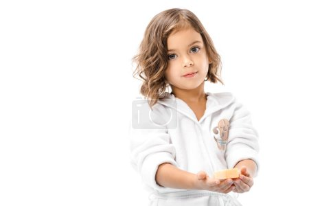 child in bathrobe holding soap in hands isolated on white