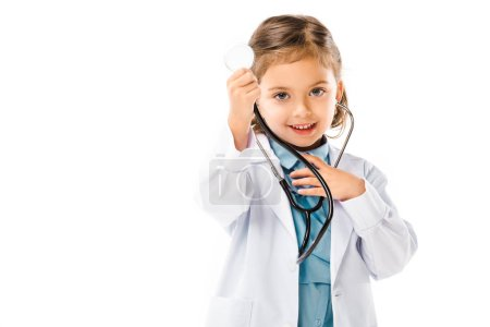 portrait of cute kid dressed in doctors white coat with stethoscope isolated on white