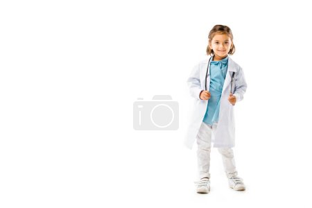 smiling kid dressed in doctors white coat with stethoscope isolated on white
