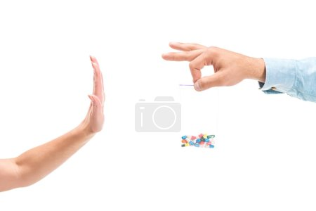 cropped image of woman rejecting unhealthy pills isolated on white