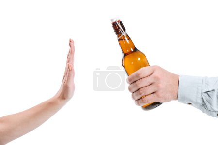 cropped image of woman rejecting bottle of beer isolated on white