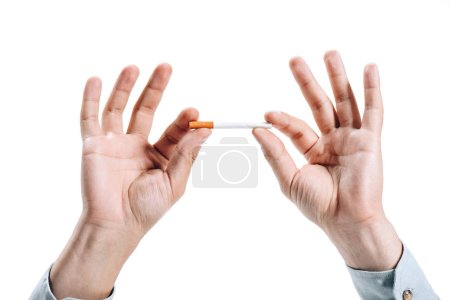 cropped image of man holding unhealthy cigarette isolated on white