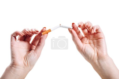 Photo for Cropped image of woman breaking unhealthy cigarette isolated on white - Royalty Free Image