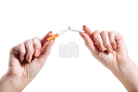 cropped image of girl breaking unhealthy cigarette isolated on white