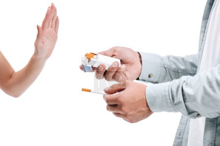 cropped image woman rejecting pack of cigarettes from man isolated on white