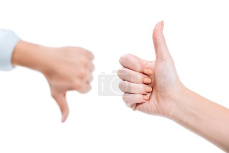 selective focus of woman and man showing thumb up and thumb down isolated on white