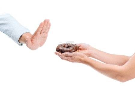 cropped image of man rejecting unhealthy chocolate doughnut isolated on white