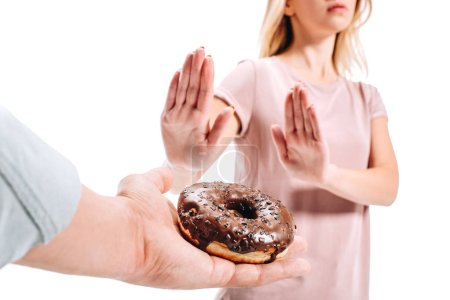 cropped image of woman rejecting chocolate doughnut isolated on white