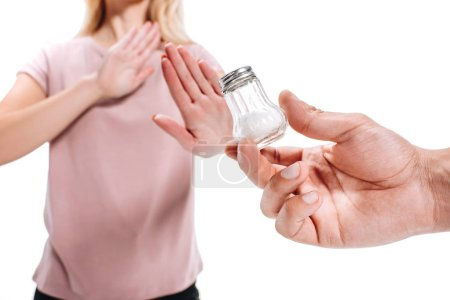 cropped image of woman rejecting unhealthy salt isolated on white