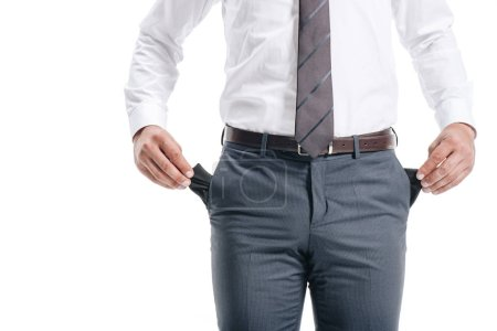 Photo for Cropped image of businessman man showing empty pockets isolated on white - Royalty Free Image
