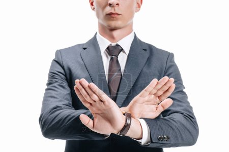 cropped image of businessman in suit showing rejection sign isolated on white