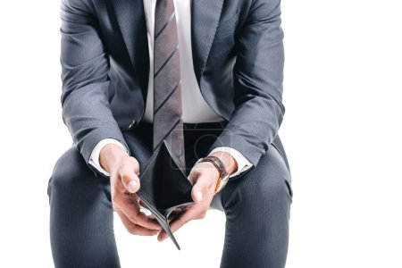 Cropped image of businessman sitting and holding o...