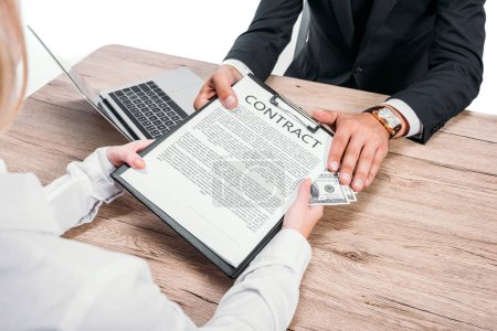 cropped image of businessman rejecting bribe in clipboard with contract in office isolated on white