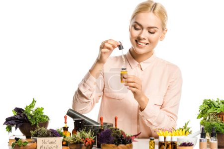 Photo for Smiling woman making essential oil isolated on white - Royalty Free Image