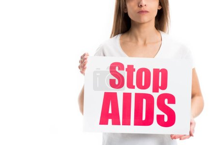 cropped image of woman holding card with stop aids text isolated on white, world aids day concept