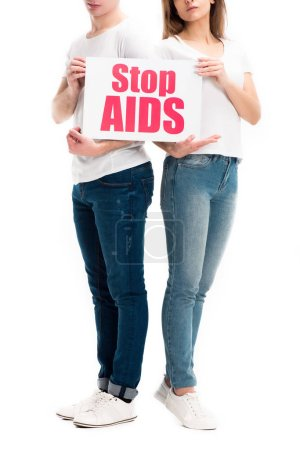 cropped image of heterosexual couple holding card with stop aids text isolated on white