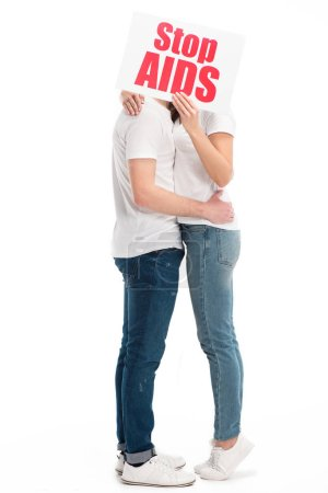 couple kissing and covering faces with card with stop aids text isolated on white, world aids day concept