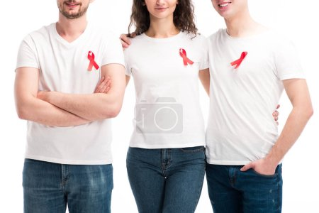 cropped image of men and woman with red ribbons hugging isolated on white, world aids day concept