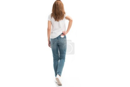 back view of woman taking condom from pocket isolated on white, world aids day concept