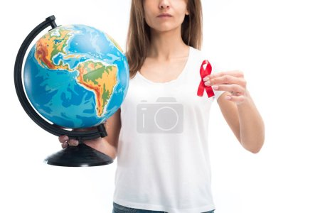 cropped image of woman holding globe and red ribbon isolated on white, world aids day concept