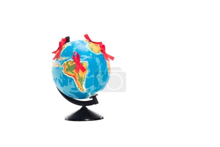 globe with red ribbons isolated on white, world aids day concept