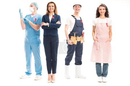 Photo pour Femme d'affaires heureuse, médecin, travailleur et femme au foyer debout avec des rubans rouges isolés sur blanc, concept de journée mondiale sida - image libre de droit
