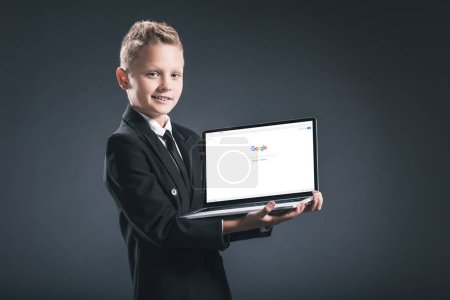 smiling boy in businessman suit