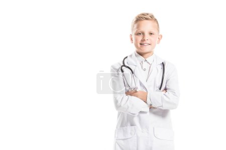 Photo for Portrait of smiling preteen boy in doctors white coat with stethoscope isolated on white - Royalty Free Image