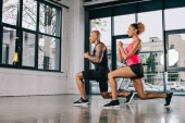 happy young african american couple of athletes exercising at gym