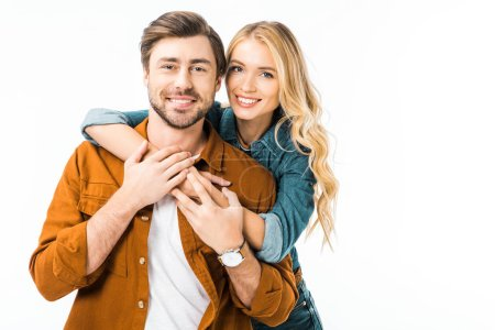 portrait of cheerful couple embracing each other isolated on white