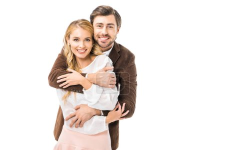 Photo for Happy stylish man in jacket hugging girlfriend isolated on white - Royalty Free Image