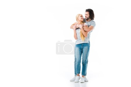 Romantic couple hugging and looking at each other isolated on white