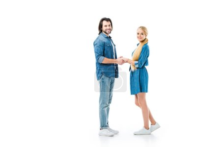Pretty couple holding hands and looking at camera isolated on white