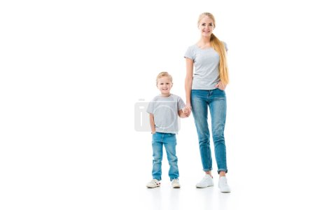 Mom and son holding hands and looking at camera isolated on white