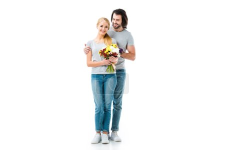Happy couple hugging and girl holding flowers isolated on white