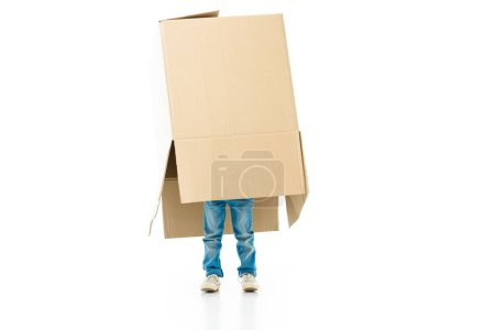 Photo for Child hiding in the paper box preparing for moving isolated on white - Royalty Free Image