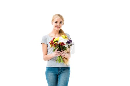 Pretty blonde girl holding flowers and looking at camera
