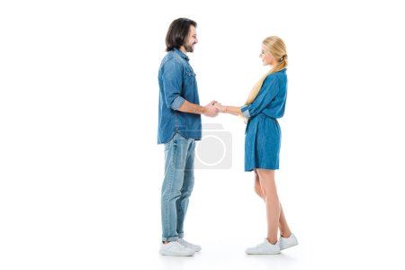 Photo for Man and woman holding hands and looking at each other isolated on white - Royalty Free Image