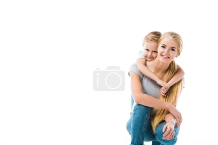 Little happy son hugging his beautiful mother isolated on white