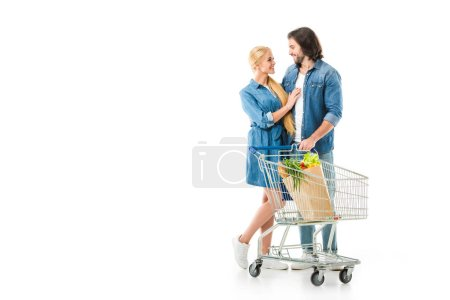 Man and woman after shopping hugging and smiling isolated on white