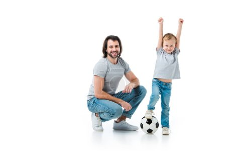 happy father and excited son playing football isolated on white