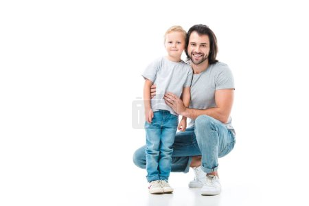Father and son hugging and smiling isolated on white