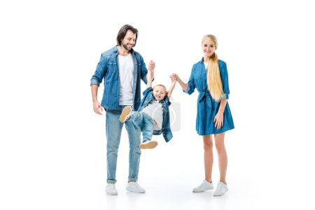 Lovely parents throwing up their child while holding hands isolated on white