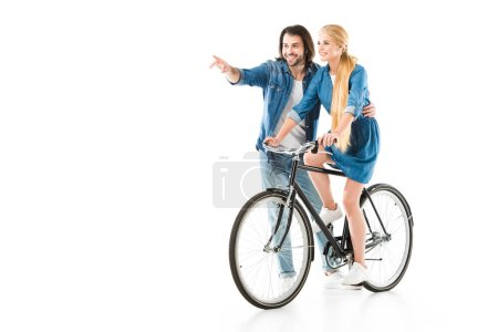 Happy couple having fun while woman riding bicycle isolated on white